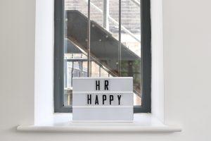 sign reading 'hr happy'